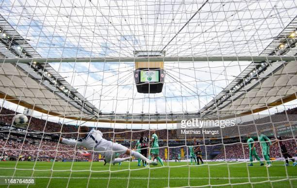 Oliver Baumann of TSG 1899 Hoffenheim fails to stop Martin Hinteregger of Eintracht Frankfurt from scoring his team's first goal during the...