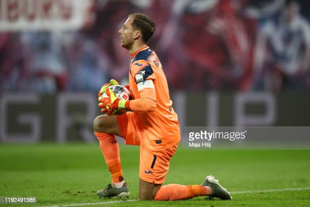 Oliver Baumann of TSG 1899 Hoffenheim gathers the ball during the Bundesliga match between RB Leipzig and TSG 1899 Hoffenheim at Red Bull Arena on...
