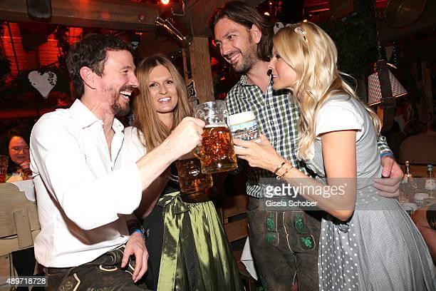 Oliver Berben and his wife Katrin Berben and Max Wiedemann and his partner Tina Kaiser during the Oktoberfest 2015 at Kaeferschaenke at...