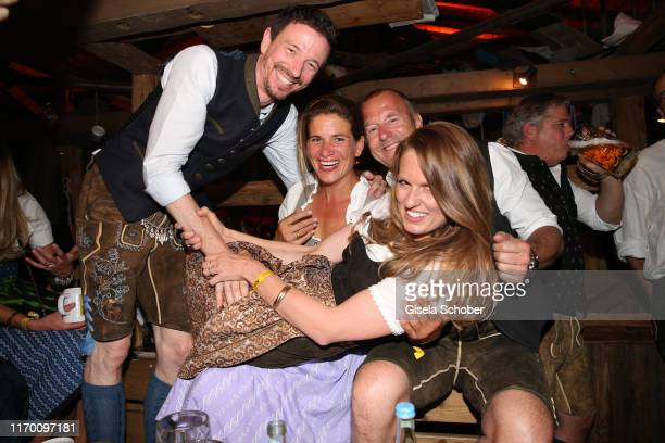 Oliver Berben and his wife Katrin Heino Ferch and his wife Marie Jeanette Ferch during the Oktoberfest 2019 opening at Theresienwiese on September 21...