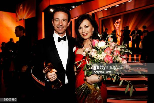 Oliver Berben poses with his Goldene Kamera Best TV Movie National award for the movie 'Liebesjahre' next to his mother Iris Berben during the 47th...