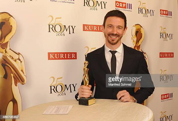 Oliver Berben poses with the Romy statue at the Romy 2014 Academy Awards at Hofburg Vienna on April 24 2014 in Vienna Austria