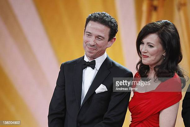 Oliver Berben receives the Goldene Kamera Best TV Movie National for the movie 'Liebesjahre' next to his mother Iris Berben during the 47th Golden...