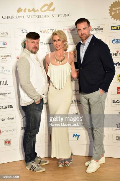 Oliver Bernhard and his wife Ramona Bernhard and Christoph Metzelder attend the Pre Golf Party during the 9th Golf Charity Cup hosted by the...
