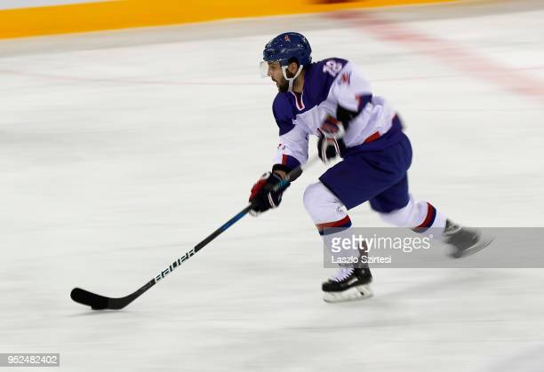 Oliver Betteridge of Great Britain controls the puck during the 2018 IIHF Ice Hockey World Championship Division I Group A match between Italy and...