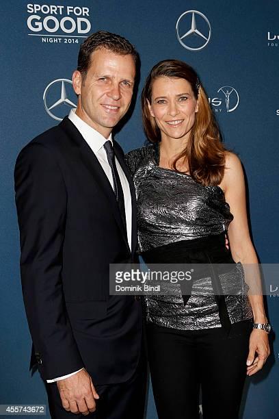 Oliver Bierhoff and Klara Szalantzy attend the Laureus Sport for Good Night 2014 at Bayerischer Hof on September 19 2014 in Munich Germany