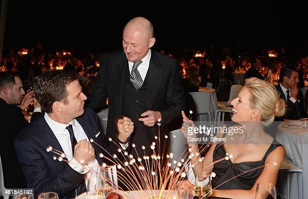 Oliver Bierhoff IWC CEO Georges Kern and Karolina Kurkova attend the IWC 'Journey To The Stars' Gala Dinner during the Salon International de la...