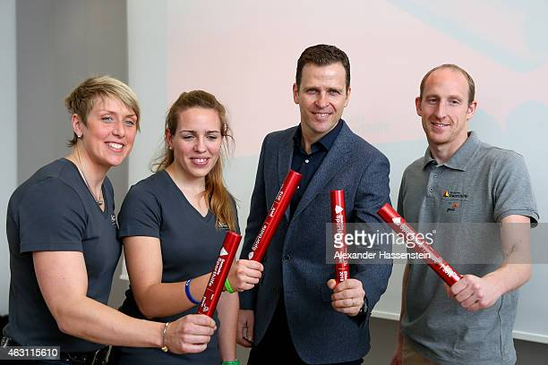 Oliver Bierhoff manager of the German national football team pose with Christina Obergfoell Lisa Schmidla and Thomas Lurz after the Deutsche...
