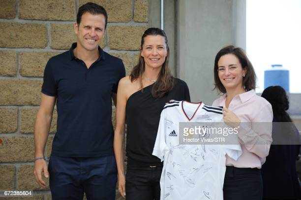 Oliver Bierhoff team manager of the German national team Klara Bierhoff and Laura Franco President of Laureles Foundation holds a signed Germany...