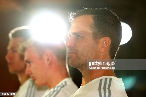 Oliver Bierhoff team manager of the German national team looks on with his players Julian Brandt and Joshua Kimmich during a Press Conference of the...