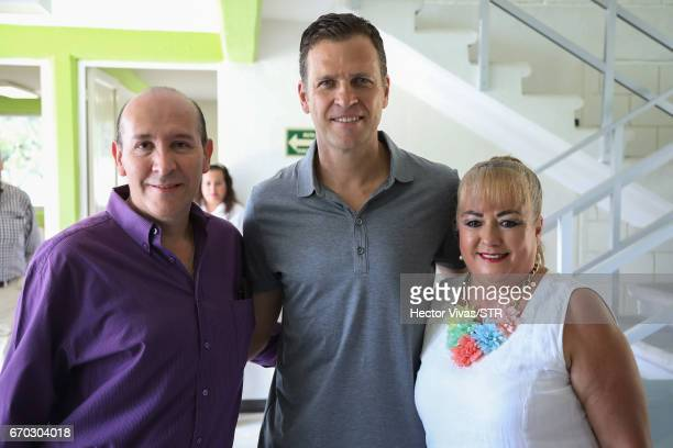 Oliver Bierhoff team manager of the German national team pose with Luis Ramirez and Alejandra Bustamante of Icatech during the visit and unveiling of...