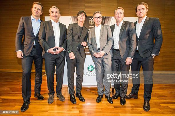 Oliver Bierhoff Wolfgang Niersbach Joachim Loew Helmut Sandrock Andreas Koepke and Thomas Schneider pose during a press conference to announce the...