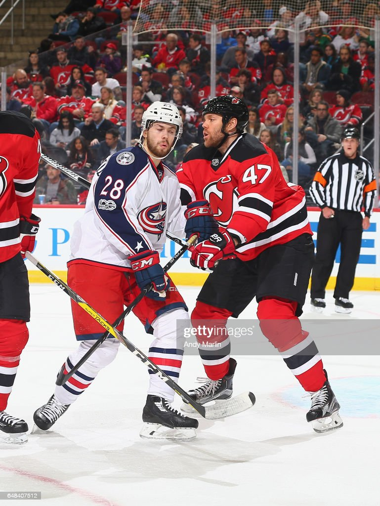 Oliver Bjorkstrand #28 of the Columbus Blue Jackets and Dalton Prout #47 of the New Jersey Devils battle for position during the game at Prudential Center on March 5, 2017 in Newark, New Jersey.