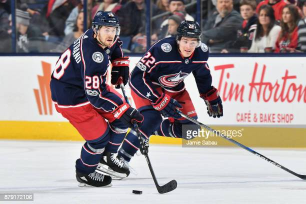 Oliver Bjorkstrand of the Columbus Blue Jackets and Sonny Milano of the Columbus Blue Jackets skate against the Calgary Flames on November 22 2017 at...