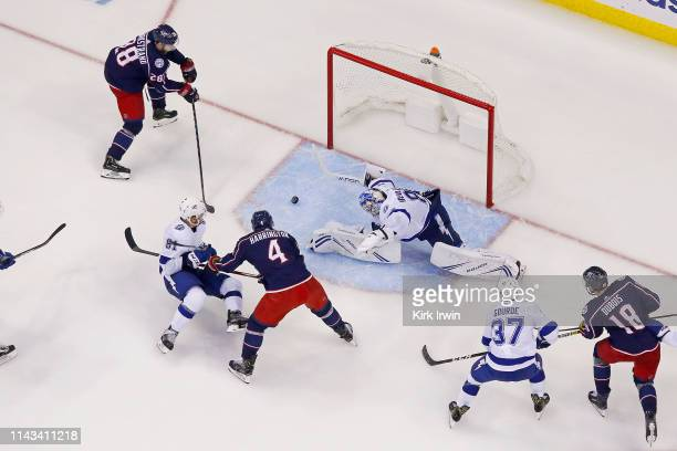 Oliver Bjorkstrand of the Columbus Blue Jackets beats Andrei Vasilevskiy of the Tampa Bay Lightning for a goal in Game Four of the Eastern Conference...