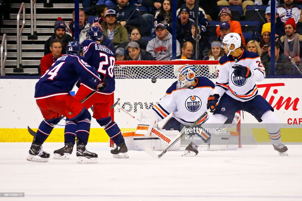 Oliver Bjorkstrand #28 of the Columbus Blue Jackets beats Laurent Brossoit #1 of the Edmonton Oilers for a goal during the third period on December 12, 2017 at Nationwide Arena in Columbus, Ohio. Edmonton defeated Columbus 7-2.