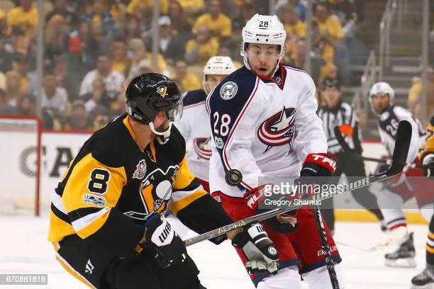 Oliver Bjorkstrand of the Columbus Blue Jackets blocks the puck off the stick of Brian Dumoulin of the Pittsburgh Penguins during the first period in...