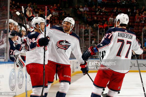 Oliver Bjorkstrand of the Columbus Blue Jackets celebrates a goal with teammates Seth Jones and Josh Anderson against the Florida Panthers at the BBT...