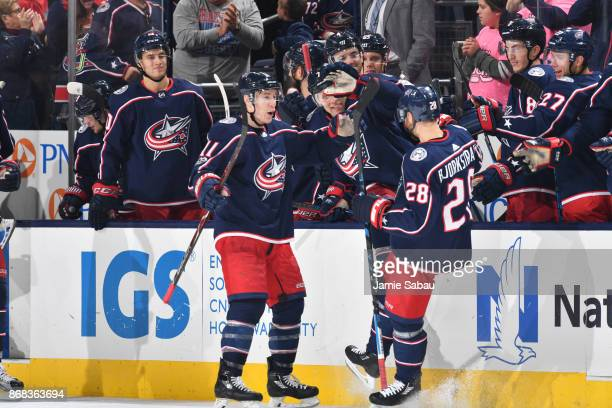 Oliver Bjorkstrand of the Columbus Blue Jackets celebrates with Matt Calvert of the Columbus Blue Jackets after scoring the gamewinning goal during a...