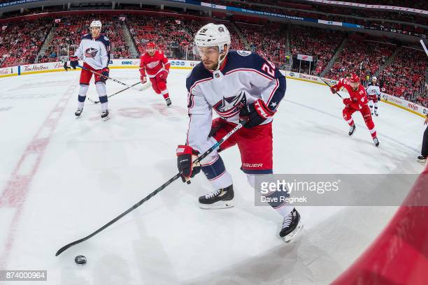 Oliver Bjorkstrand of the Columbus Blue Jackets controls the puck against the Detroit Red Wings during an NHL game at Little Caesars Arena on...