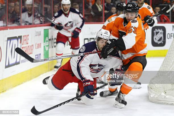 Oliver Bjorkstrand of the Columbus Blue Jackets is checked by Shayne Gostisbehere of the Philadelphia Flyers during the first period at Wells Fargo...
