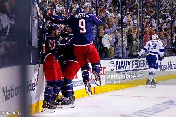 Oliver Bjorkstrand of the Columbus Blue Jackets is congratulated by his teammates after scoring a goal during Game Four of the Eastern Conference...