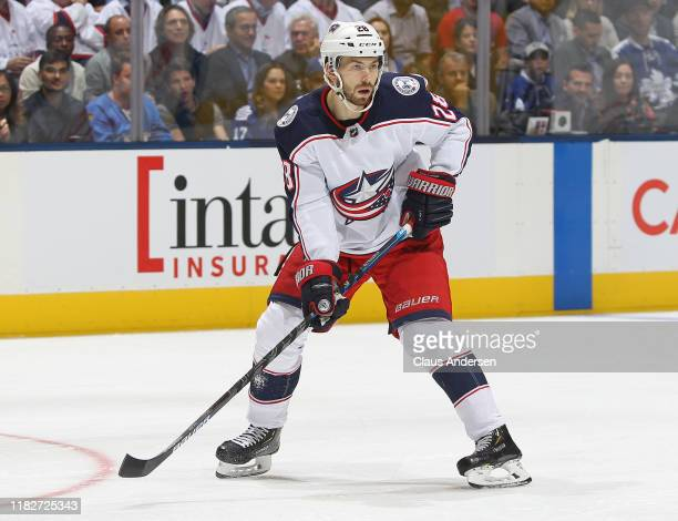 Oliver Bjorkstrand of the Columbus Blue Jackets skates against the Toronto Maple Leafs during an NHL game at Scotiabank Arena on October 21 2019 in...