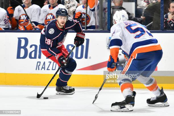 Oliver Bjorkstrand of the Columbus Blue Jackets skates with the puck as Johnny Boychuck of the New York Islanders defends during the third period of...