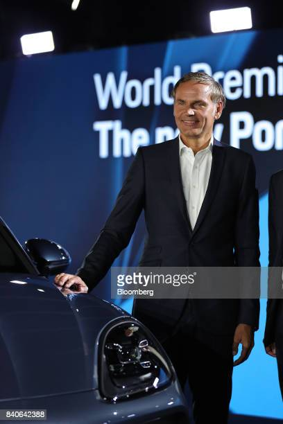 Oliver Blume chief executive officer of Porsche AG stands for a photograph with the new Cayenne sport utility vehicle during a launch event in...