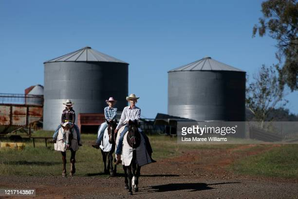 Oliver Bowman Alessia Bowman and Sybella Bowman ride horses at their family cattle property around home schooling sessions on April 05, 2020 in...