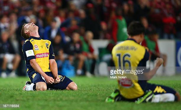 Oliver Bozanic and Trent Sainsbury celebrate victory after the ALeague 2013 Grand Final match between the Western Sydney Wanderers and the Central...