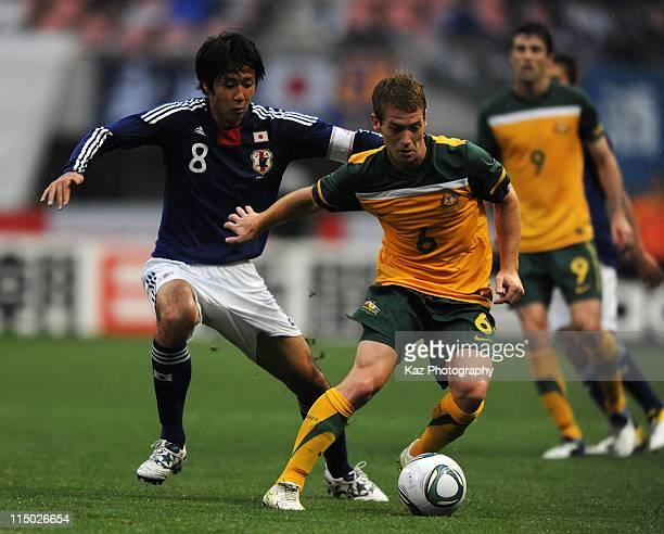 Oliver Bozanic of Australia and Kazuya Yamamura of Japan compete for the ball during the international friendly match between U-22 Japan and U-22...