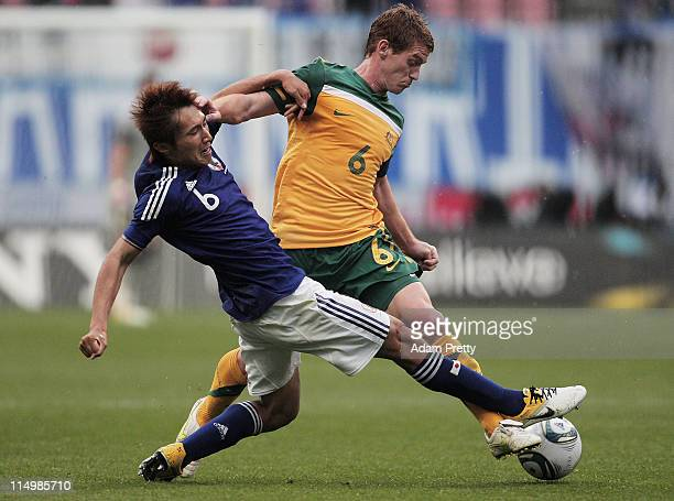 Oliver Bozanic of Australia is challenged by Taisuke Muramatsu of Japan during the international friendly match between U22 Japan and U22 Australia...
