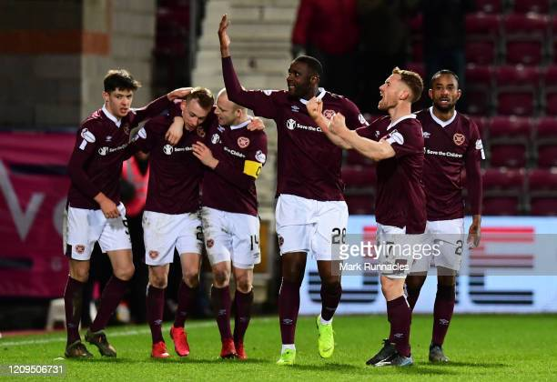 Oliver Bozanic of Hearts celebrates after scoring his sides first goal during the Scottish Cup Quarter Final match between Hearts and Rangers at...