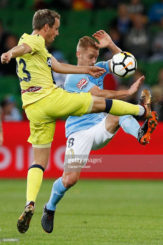 Oliver Bozanic of Melbourne City and Wout Brama of Central Coast Mariners contest the ball during the round 26 A-League match between Melbourne City and the Central Coast Mariners at AAMI Park on April 7, 2018 in Melbourne, Australia.