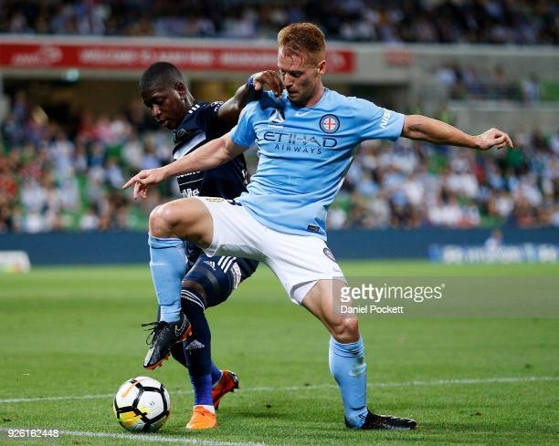 Oliver Bozanic of Melbourne City contests the ball with Leroy George of the Victory during the round 22 ALeague match between Melbourne City FC and...
