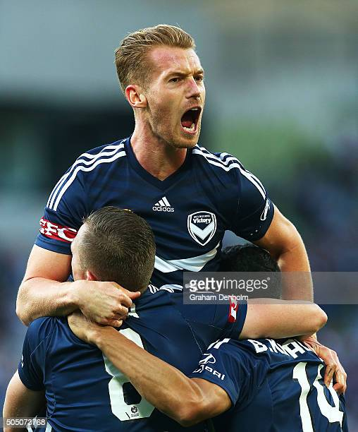 Oliver Bozanic of Melbourne Victory celebrates with Fahid Ben Khalfallah of Melbourne Victory and Besart Berisha of Melbourne Victory during the...