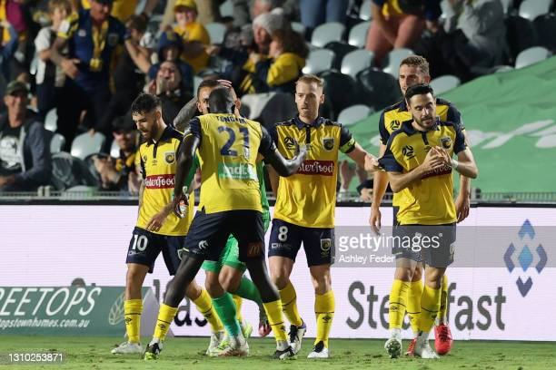 Oliver Bozanic of the Mariners celebrates his goal with team mates during the A-League match between the Central Coast Mariners and Adelaide United...