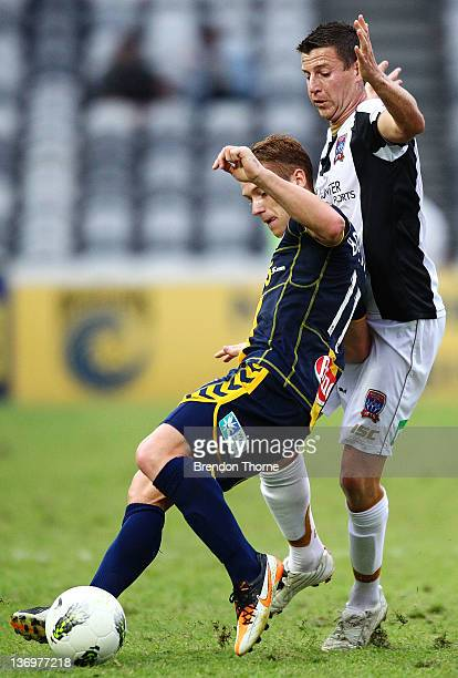 Oliver Bozanic of the Mariners competes with Michael Bridges of the Jets during the round 14 ALeague match between the Central Coast Mariners and the...