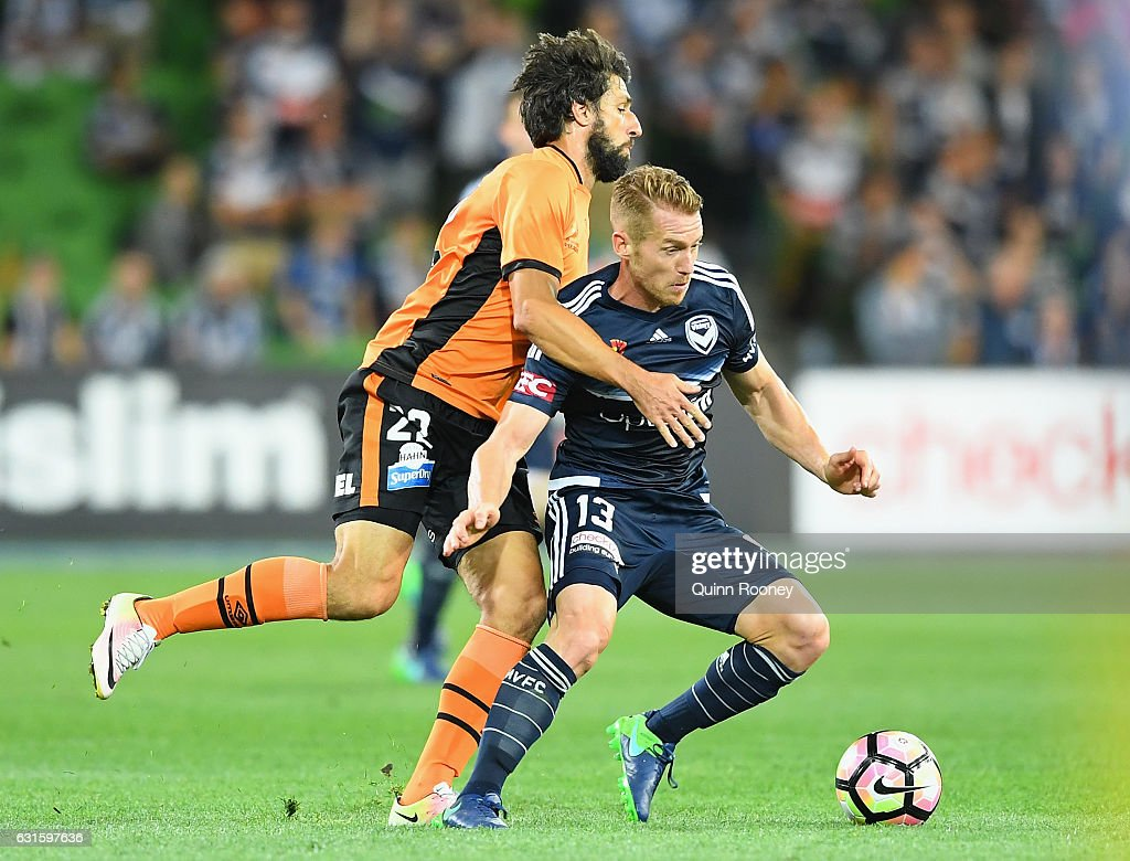 Oliver Bozanic of the Victory is challenged by Thomas Broich of the Roar during the round 15 A-League match between the Melbourne Victory and the Brisbane Roar at AAMI Park on January 13, 2017 in Melbourne, Australia.