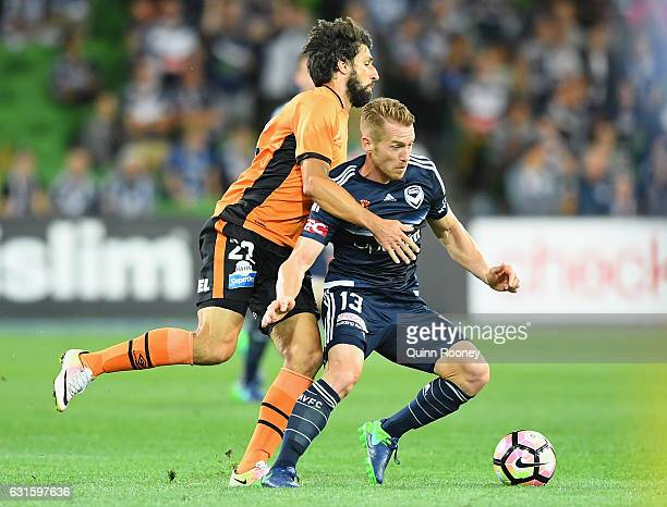 Oliver Bozanic of the Victory is challenged by Thomas Broich of the Roar during the round 15 ALeague match between the Melbourne Victory and the...