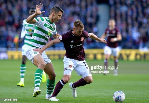 Oliver Bozniac of Heart of Midlothian FC holds off Filip Benkovic of Celtic during the Betfred Scottish League Cup Semi Final between Heart of...
