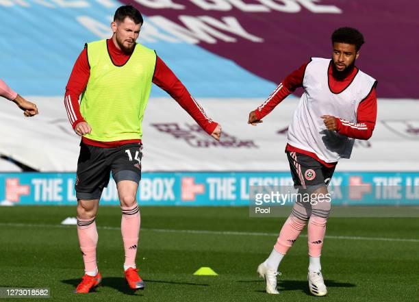 Oliver Burke and Jayden Bogle of Sheffield United warm up prior to the Carabao Cup second round match between Burnley and Sheffield United at Turf...
