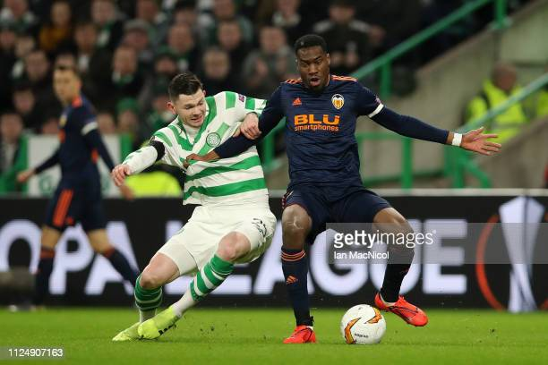 Oliver Burke of Celtic battles for possession with Geoffrey Kondogbia of Valencia during the UEFA Europa League Round of 32 First Leg match between...