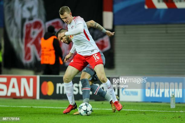 Oliver Burke of Leipzig and Alvaro Negredo of Besiktas battle for the ball during the UEFA Champions League group G soccer match between RB Leipzig...