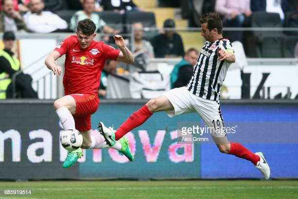 Oliver Burke of Leipzig is challenged by David Abraham of Frankfurt during the Bundesliga match between Eintracht Frankfurt and RB Leipzig at...