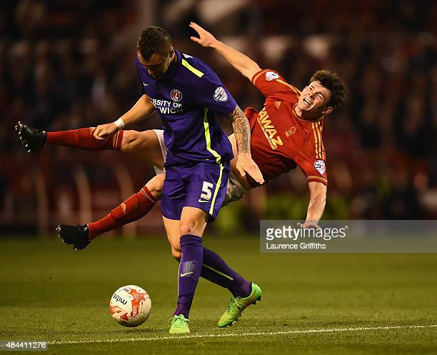 Oliver Burke of Nottingam Forest battles with Patrick Bauer of Charlton Athletic during the Sky Bet Championship match between Nottingham Forest and...