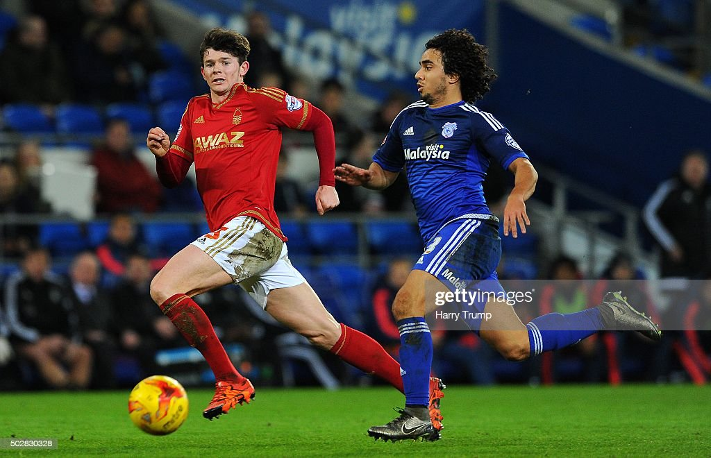Oliver Burke of Nottingham Forest is tackled by Fabio of Cardiff City during the Sky Bet Championship match between Cardiff City and Nottingham Forest at the Cardiff City Stadium on December 29, 2015 in Cardiff, Wales.