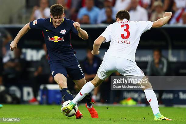 Oliver Burke of RB Leipzig battles for the ball with Dominique Heintz of Koeln during the Bundesliga match between 1 FC Koeln and RB Leipzig at...