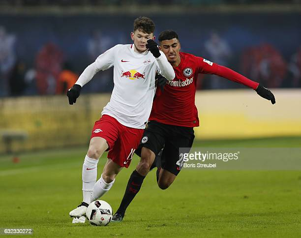 Oliver Burke of RB Leipzig is challenged by Aymen Barkok of Eintracht Frankfurt during the Bundesliga match between RB Leipzig and Eintracht...